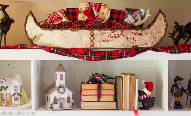 Birch bark canoe filled with presents and antler in lodge style Christmas family room