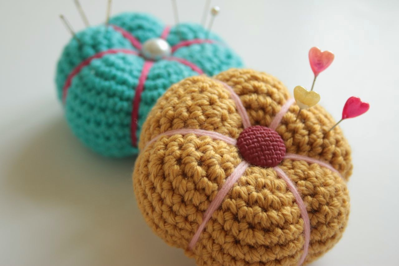 Squashed tomato crocheted pincushion