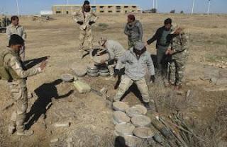 الجيش العراقي و الحشد الشعبي تفكيك عبوات ناسفة و قناني اوكسجين في الريحانة وعانه غرب الانبار