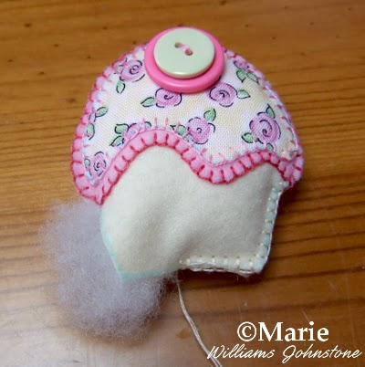 Using toy stuffing to plump up a hand sewn item