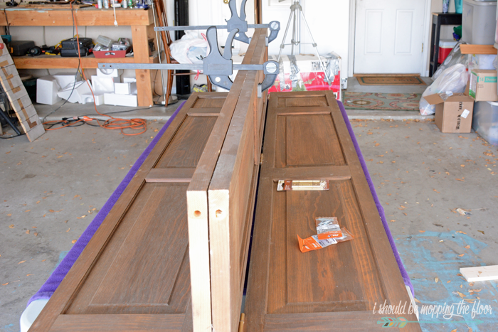 How to Make a Headboard Out of Bifold Doors | Tutorial on creating a large headboard with old doors.