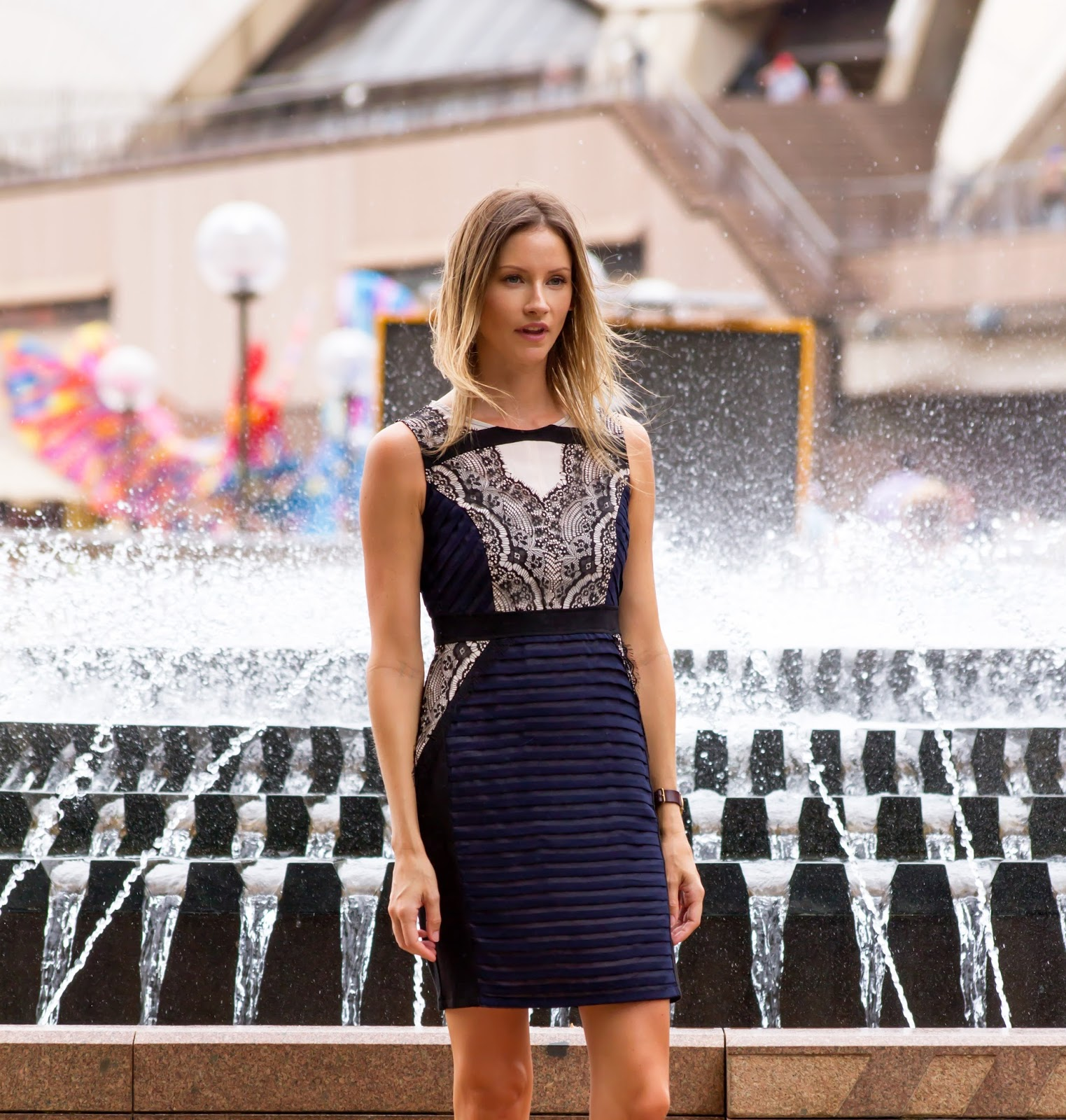 fashion and travel blogger, Alison Hutchinson at the Sydney Harbour in a workwear navy and black lace dress