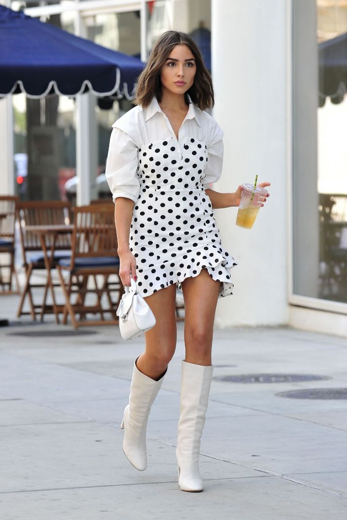 Olivia Culpo in Polkadot Dress Over a Classic Shirt Dress in Los Angeles Photos