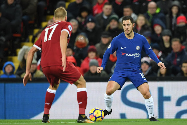 Chelsea star Eden Hazard takes on Liverpool defender