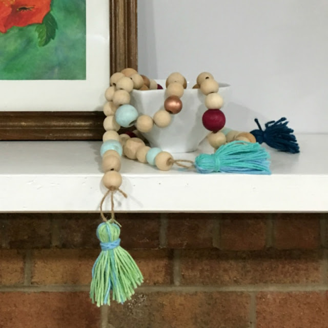Make a colorful wooden bead garland that you could use as a necklace or home decor!