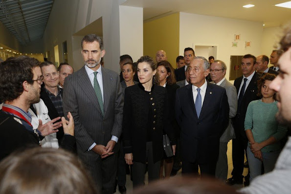 Queen Letizia wore a Zara Military Jacket, Magrit suede shoes. Hugo Boss trousers, Hugo Boss blouse, Dolce & Gabbana bag