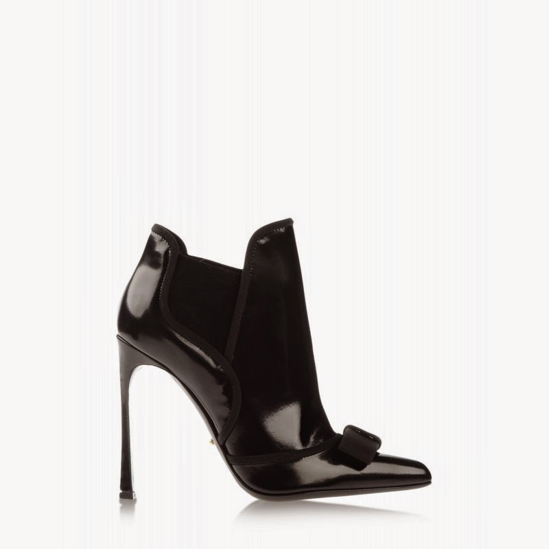 http://shop.harpersbazaar.com/new-arrivals/the-best-of-whats-new/sergio-rossi-black-bow-bootie/