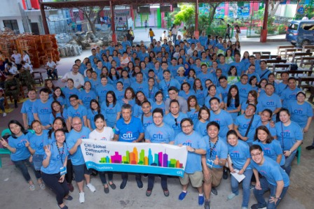 Citi Philippines CEO Aftab Ahmed (center) with Citi volunteers at the Upper Bicutan Elementary School in Taguig
