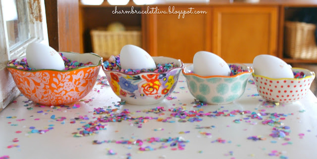 Hand stamped Easter eggs in Pioneer Woman measuring cups confetti