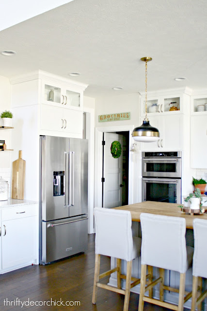 White kitchen with wood and gray island