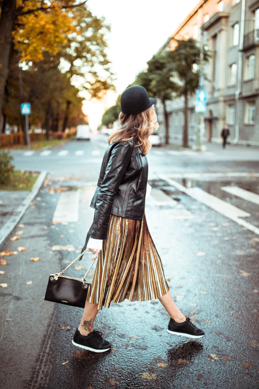pleated skirt leather jacket sneakers fall street style