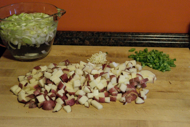 The ingredients chopped up on the cutting board.
