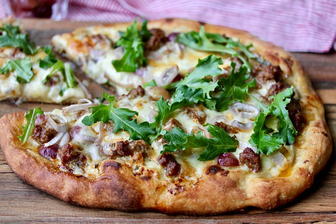 Sausage and Cambozola Pizza with Arugula, Grapes, and Fontina