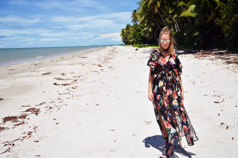 australian blogger on tropical beach wearing rose print maxi kimono western buckle belt lace up choker round sunglasses