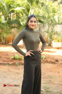 Tollywood Actress Punarnavi Bhupalam Latest Po Gallery in Black Trouser Pant at Pittagoda Movie Interview  0069.JPG