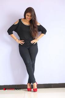 Actress Kiran Chetwani Pictures in Black Jeans at Lakshmidevi Samarpinchu Nede Chudandi Platinum Disc Function  0162
