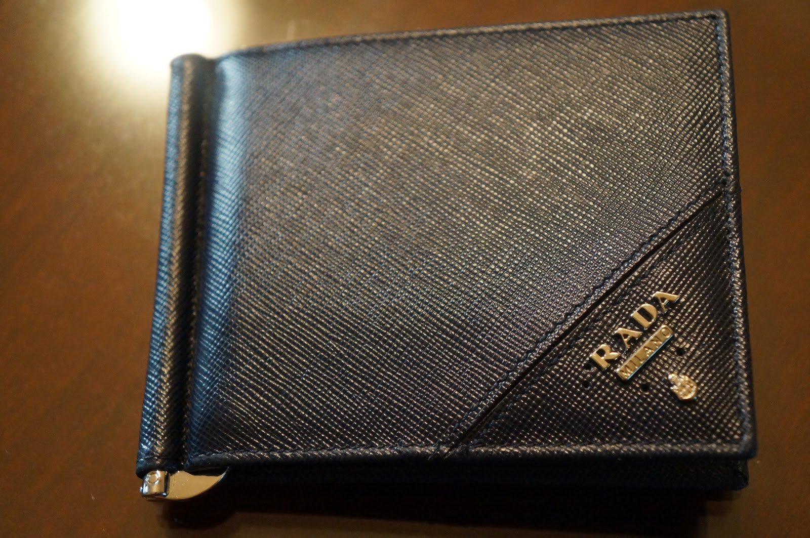 07c256bdb0c0 ... Prada Safiano Money Clip Wallet for our three year anniversary (she's  awesome!) back in July. Well, after several months of heavy duty use, ...