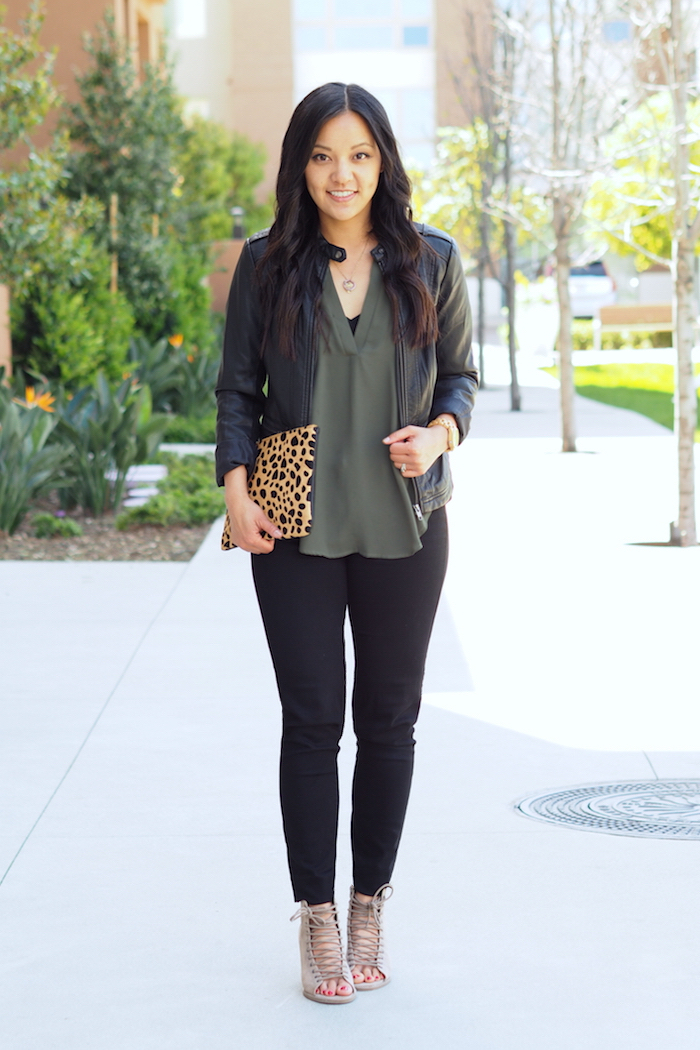 olive top + black jeans + leopard clutch + strappy heels