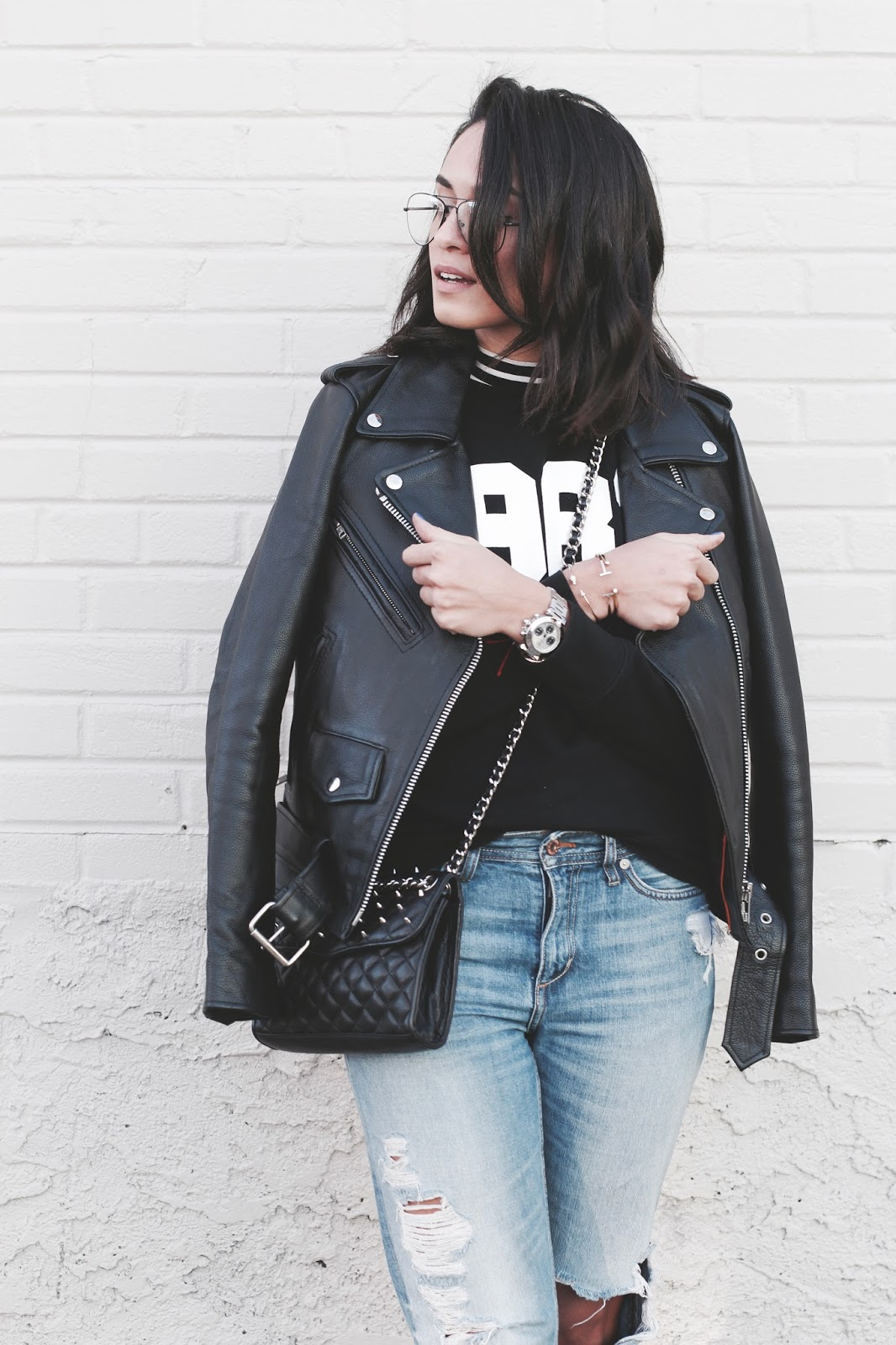 Picture of blogger, Chelsea as of Late, wearing the PERFORMANCE LEATHER CLASSIC ASYMMETRICAL CYCLE JACKET W/SIDE LACING.