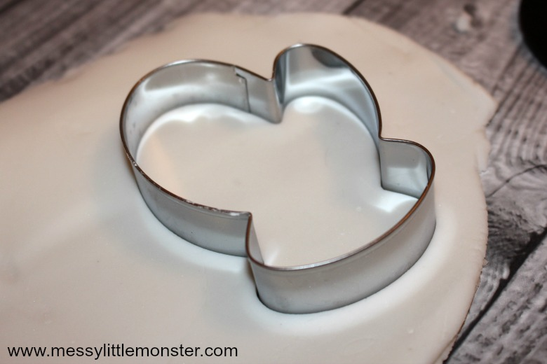 Homemade white clay ornaments using a mitten cookie cutter