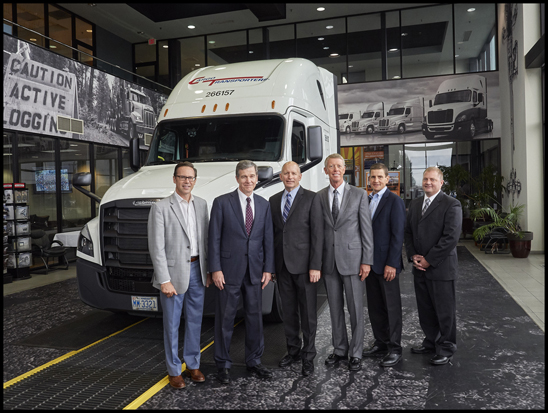 From left to right: DTNA Senior Vice President of Operations and Specialty Vehicles Jeff Allen, North Carolina Governor Roy Cooper, DTNA CEO Roger Nielsen, Freightliner Trucks Vice President of Sales Bob Correll, Cleveland Truck Manufacturing Plant Manager Erik Johnson and Chairman of Cargo Transporters John Pope Stand with the 50,000th Freightliner Cascadia