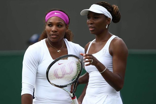 Serena and Venus Williams are in the competitive zone on the court.