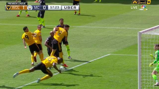 Wolves defender scores with his hand against Manchester city in a Premier League match on August 25 2018