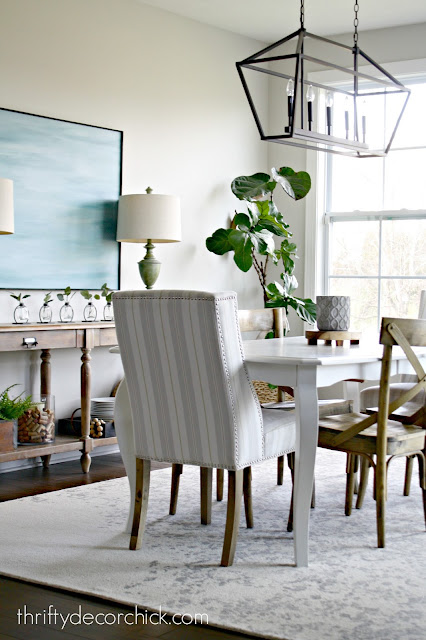 dining area with long chandelier