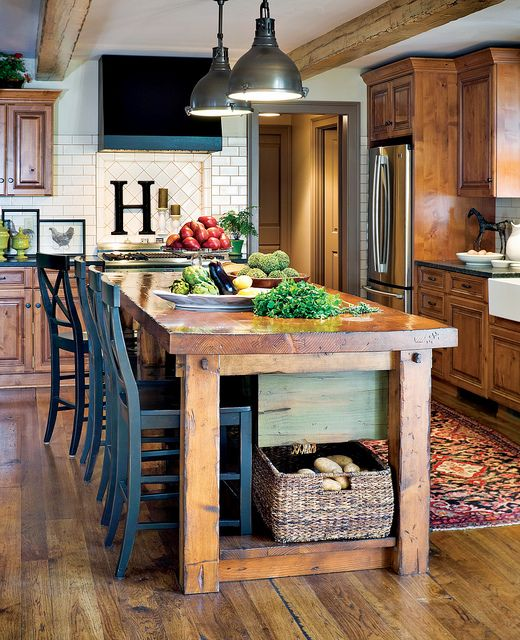 LOVE. THIS. KITCHEN. Lots of other gorgeous kitchens with wood cabinets on this site. Postcards from the Ridge