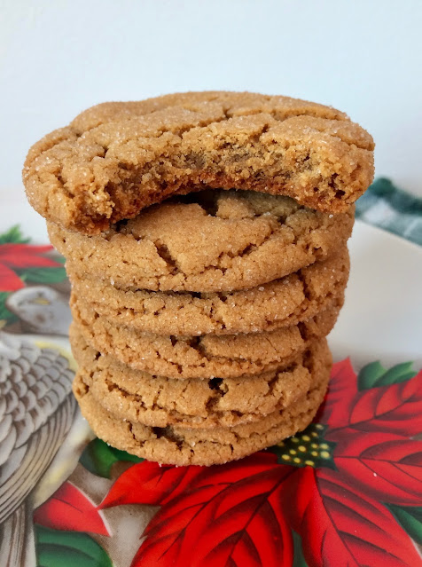 Stack of chewy molasses spice cookies with a bite taken out of the top cookie.