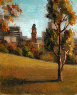 Oil painting of a distant clock tower and city scene, with trees in the middle ground and a small eucalypt in the foreground.