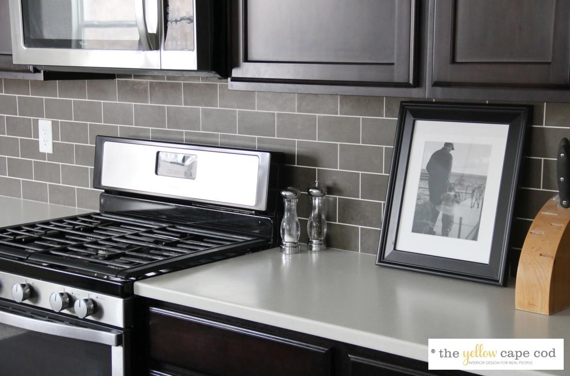 Light Grey Glass Backsplash: The Yellow Cape Cod: Dark Tile, Light Grout Kitchen Backsplash