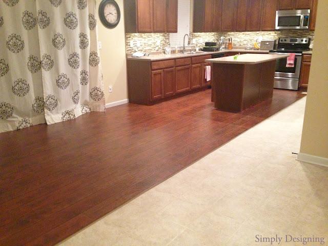 DIY Laminate Wood Flooring | #homeimprovement #flooring #diy | Simply Designing