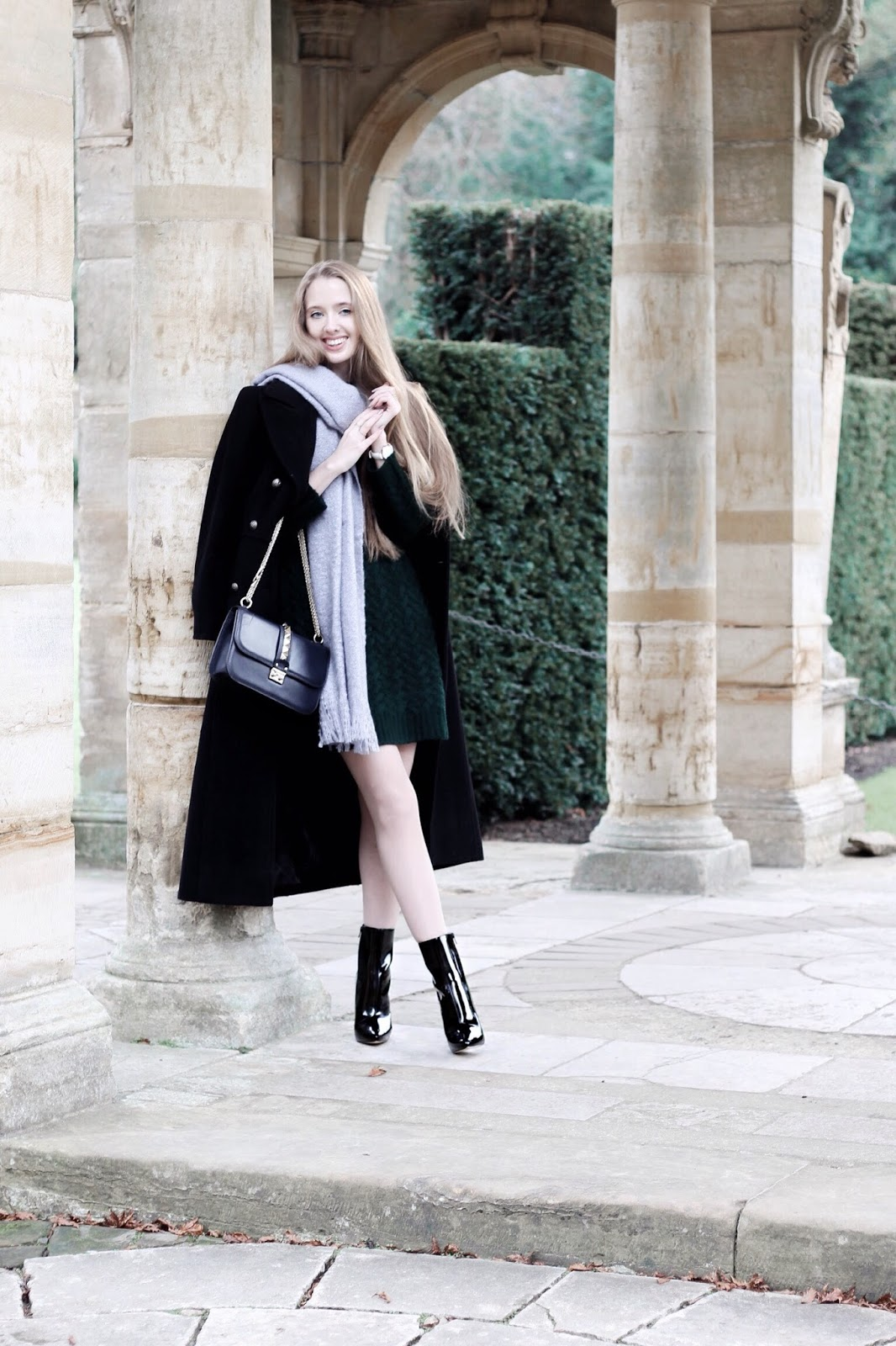 Fashion blogger layering military coat in winter