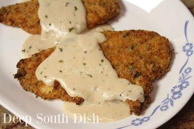 Boneless, skinless chicken breasts, pounded thin, dipped in an egg and hot sauce blend, dredged in a seasoned buttery Ritz cracker mix and pan-fried or baked, and topped with a buttery pan gravy before serving.