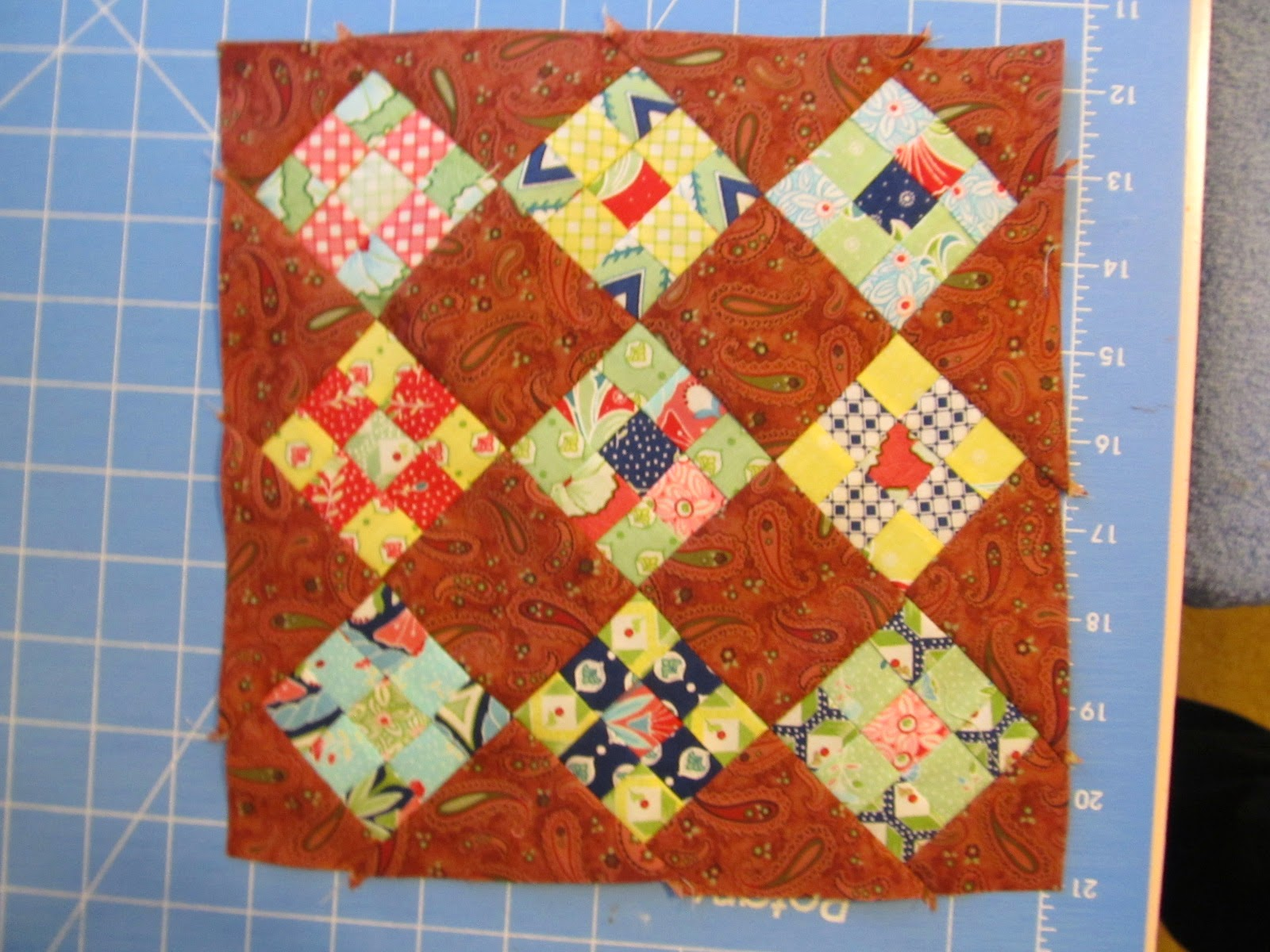 nine-patch quilt block into a quilted topper.