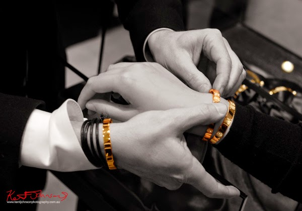 Hands, fitting the 'Eternal' bracelet on a woman's wrist, Stefano Canturi, Eternal jewellery - Canturi Photographed by Kent Johnson.