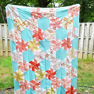 http://quiltstory.blogspot.com/2016/07/little-ruby-quilt-along-finish.html
