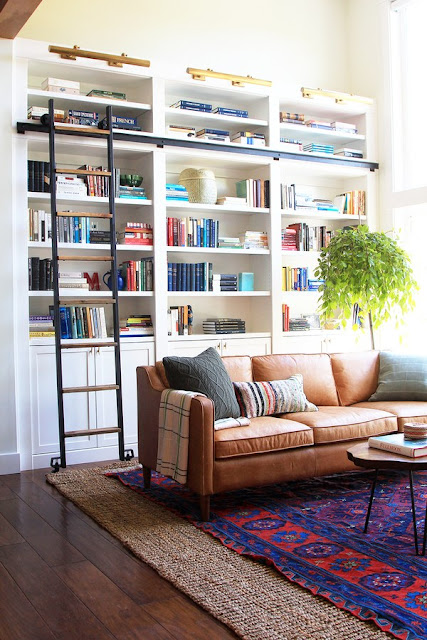 Beautiful lofty living room with library shelves and ladder - found on Hello Lovely Studio
