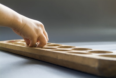 Kids Play the Mancala Board