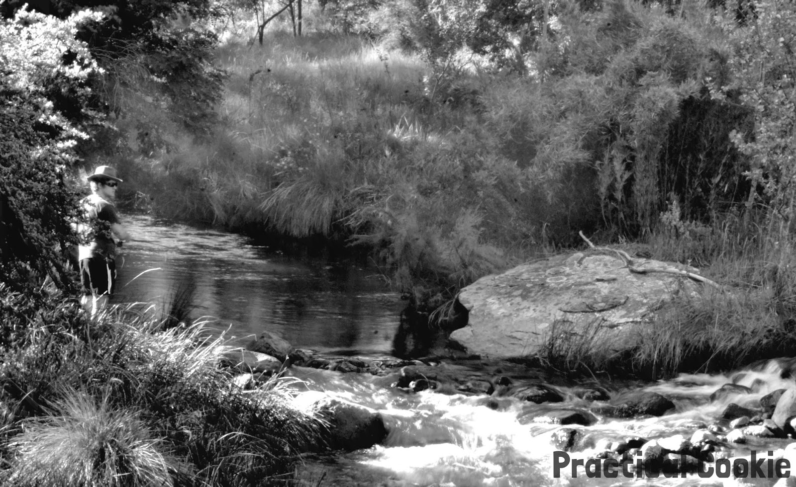 Fishing in a river black and white photography