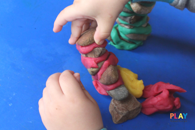 Playdough and rock tower falling over