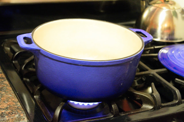 A dutch oven on the stove.