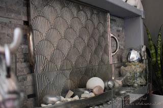 A Fireplace silver plated Fireback