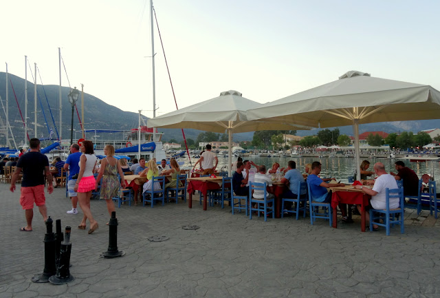Outdoor cafe and restaurant terraces on the harbour of Vasiliki
