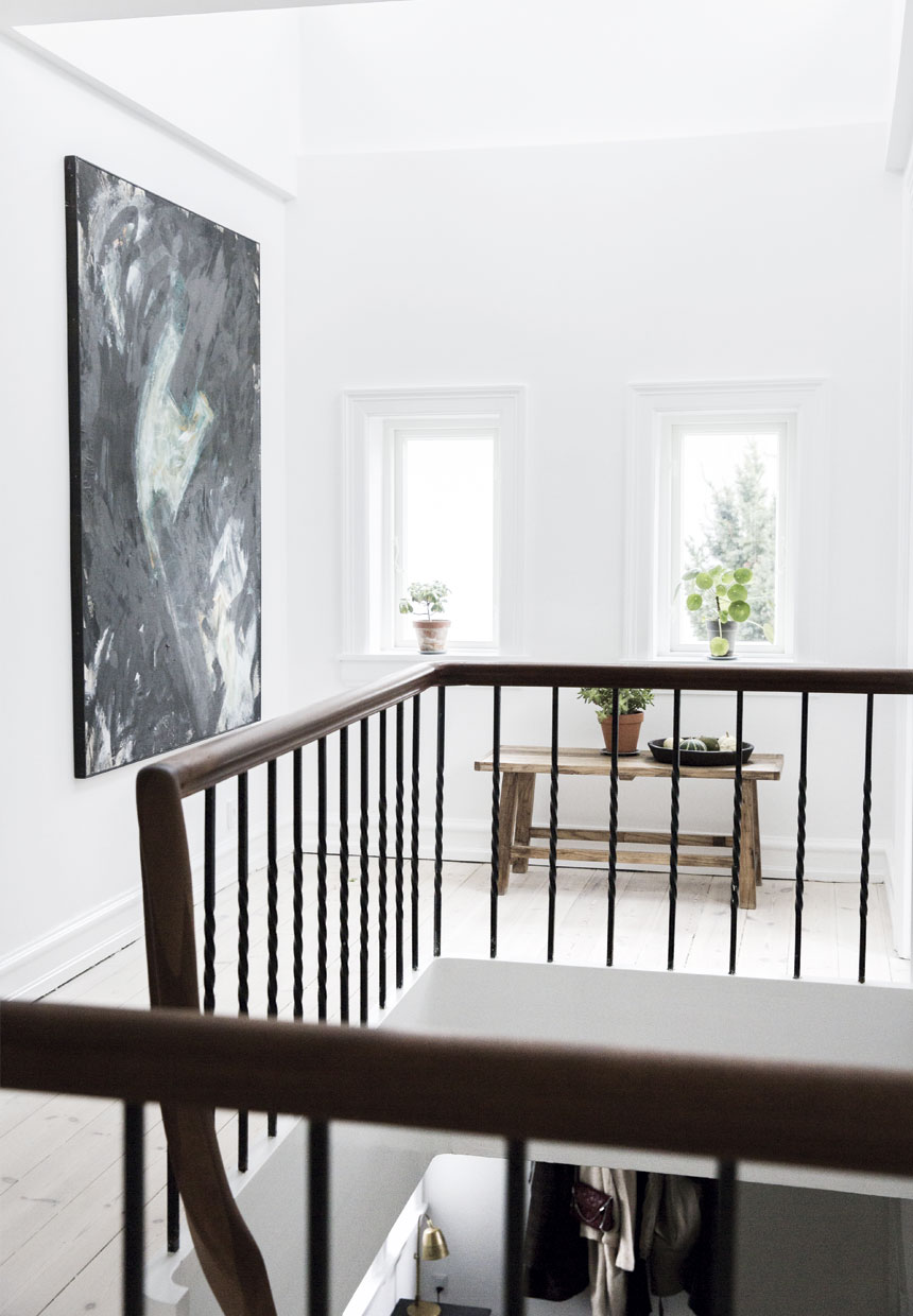 Wood railing on a staircase inside of Scandinavian villa