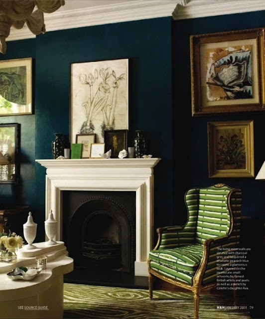 Deep teal walls in classic decorated living room on Hello Lovely