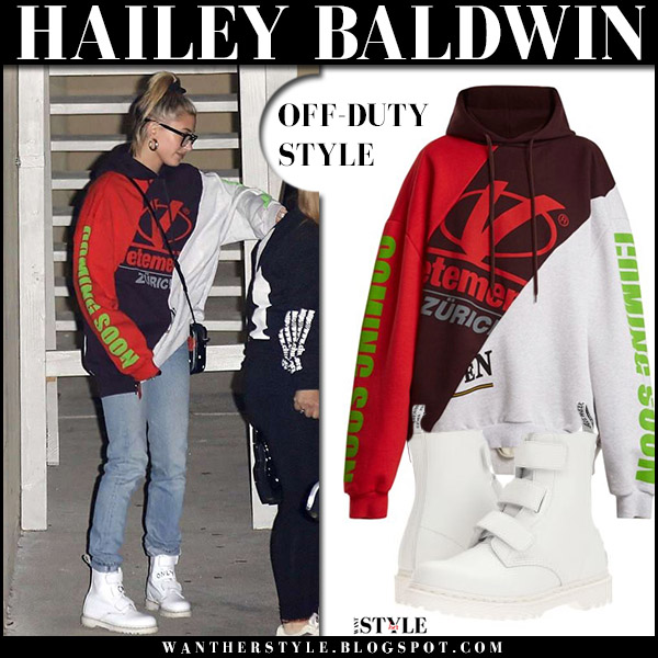 Hailey Baldwin in red and white oversized vetements zurich hoodie, jeans and white boots dr. martens coralia celebrity model street fashion april 18