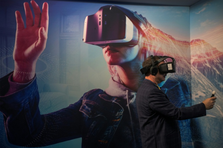 A man wearing a VR headset experiments with a merged reality experience using Project Alloy at the Intel exhibit during the 2017 Consumer Electronic Show in Las Vegas.