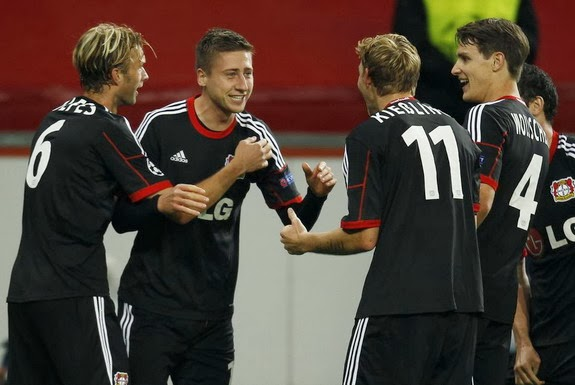 Jens Hegeler is congratulated by Leverkusen teammates after scoring against Real Sociedad